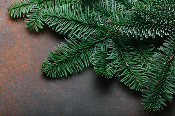 Christmas background. spruce branches on dark stone table with copy space.