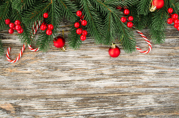 Christmas and New Year wooden background with fir tree in rustic style.