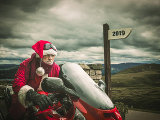 Trip of Santa Claus in 2019 on a hevy motorcycle. Active lifestyle concept