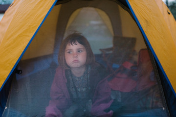 Young girl inside a tent