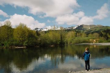 Young boy fishing at a lake