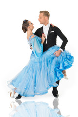 ballroom dance couple in a dance pose isolated on white background. ballroom sensual proffessional dancers dancing walz, tango, slowfox and quickstep. just dance ballroom couple
