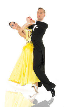 ballroom dancers. ballroom dance couple in a dance pose isolated on white background. ballroom sensual proffessional dancers dancing walz, tango, slowfox and quickstep. just dance