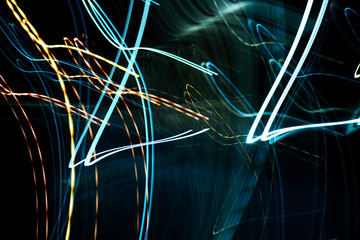 Abstract neon background of blue and yellow streaks of light
