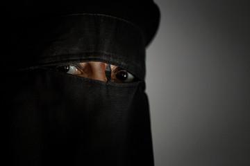 Muslim arab woman with black niqab