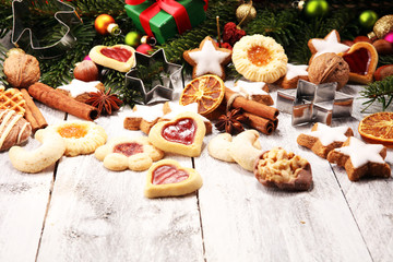 Baking christmas cookies. Typical cinnamon stars bakery for xmas with ingredients.