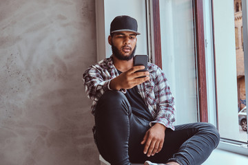African-American bearded guy chatting in the social network.
