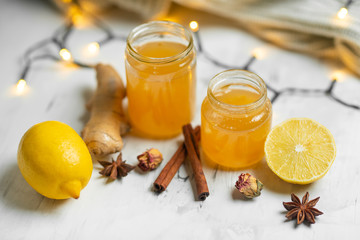 Homemade ginger and lemon jam on a light background, close-up. Natural products to support the immune system in the winter. Phytotherapy. Healthy food, health status report