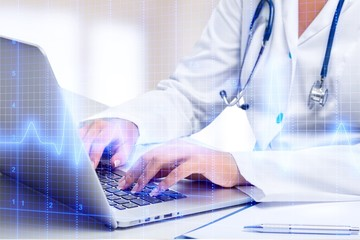 Close-up Doctor at hospital working with laptop