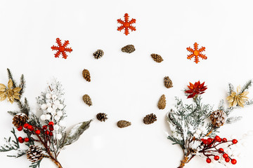 Christmas composition. Christmas decorations and a circle of pine cones on white background. Winter, christmas, new year concept. Flat lay, top view, copy space.