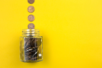 Coins with glass jar for money saving financial
