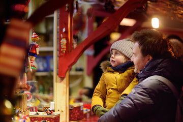 Little boy and his father having wonderful time on Xmas market