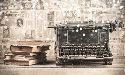 Old typewriter with books  on background