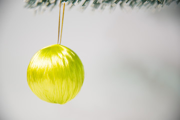 Yellow christmas ball on christmas tree