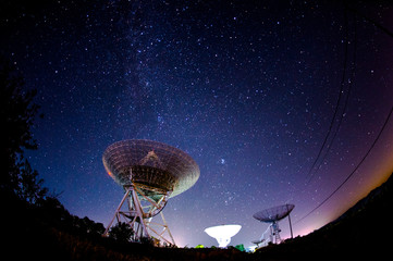 Radio telescopes and the Milky Way at night Wall mural
