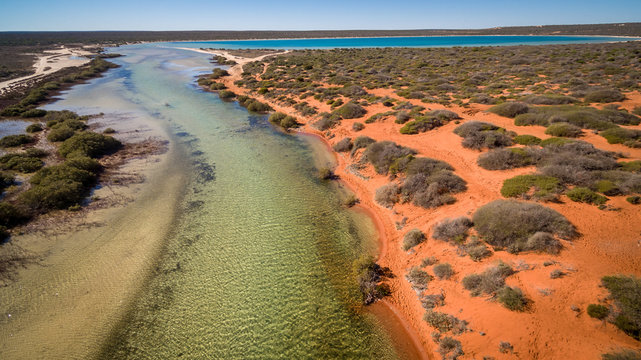 Oblique aerial view from drone of tidal creek near Denham in the World Heritage Listed Shark Bay Area.