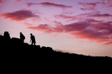 Silhouette of Hikers at Red Sunset