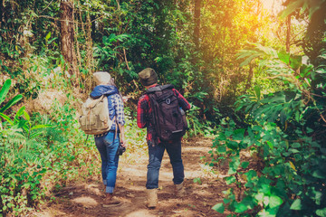 Young attractive couple hiking in the forest.