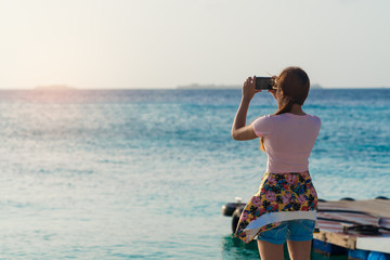 Asian beautiful woman take photo with smartphone.