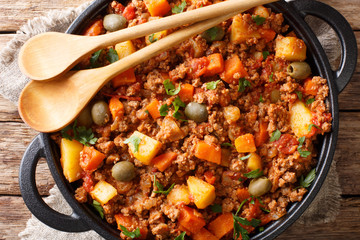 Picadillo RecipeGround beef, carrot and potatoes cooked in a tomato sauce closeup on a pan. horizontal top view