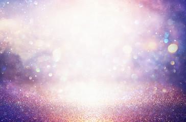 glitter vintage lights background. silver and purple. de-focused