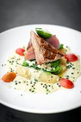 fresh seared tuna steak with creamy mustard and pepper sauce