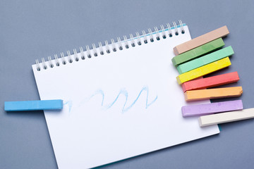 pile of multi color chalk on blue background