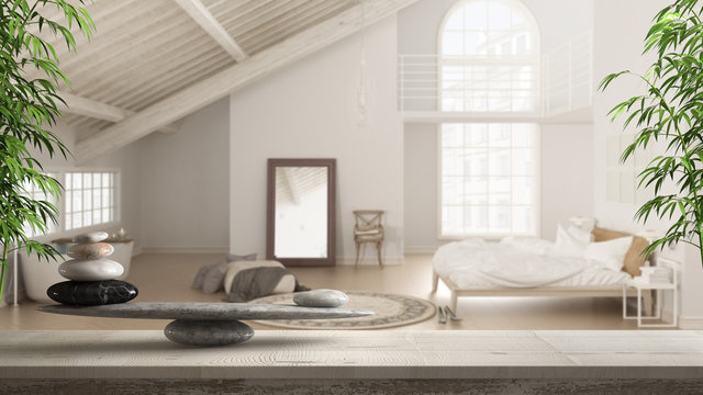 Wooden vintage table or shelf with stone balance, over blurred scandinavian loft with bedroom and bathroom with bathtub, feng shui, zen concept architecture interior design