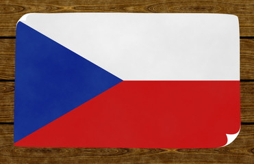 Illustration of a Czech flag on the papier pasted on the woody wall