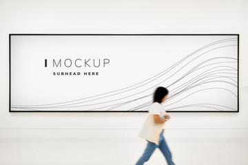 Woman walking pass a signboard mockup