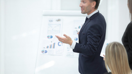 close up.businessman standing near a flipchart .photo with copy space