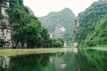 Epic mountains and river scenic landscape on adventurous boat ride in popular tourist destination in Northern Vietnam