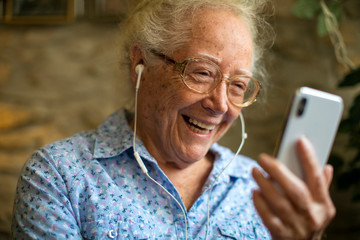 Cheerful senior woman making a video call