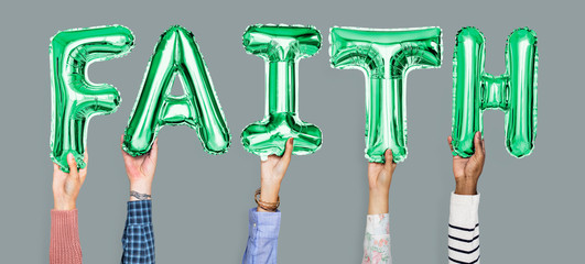 Hands holding faith word in balloon letters
