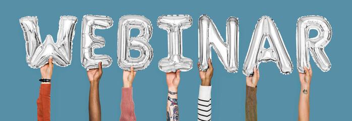 Hands holding webinar word in balloon letters