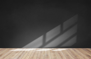 Black wall in an empty room with wooden floor