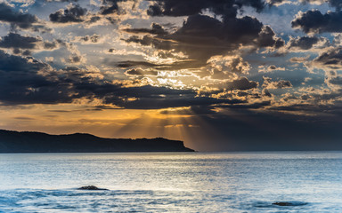 Sunrise, Sunrays, Clouds and the Sea