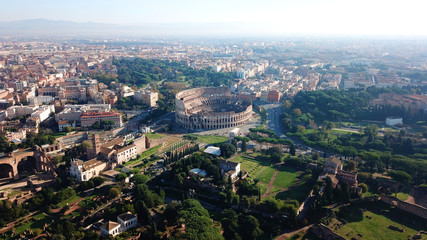 Aerial drone view of iconic ancient Arena of Colosseum, also known as the Flavian amphitheatre in the heart of Rome, Italy