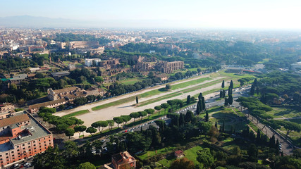 Aerial drone photo of iconic Circus Maximus site of an ancient Roman chariot racing stadium and mass entertainment venue next to famous Colosseum, Rome, Italy