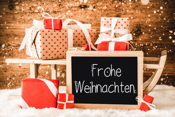 Sled With Many Gifts, Calligraphy Frohe Weihnachten Means Merry Christmas