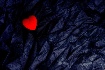 Top View Red Heart On Wrinkled Black Texture Background. Happy Valentine's Day And Love Concept. Romantic Card, Banner Graphic Design Concept.