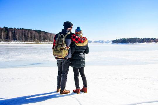 Couple enjoying the day on a frozen lake