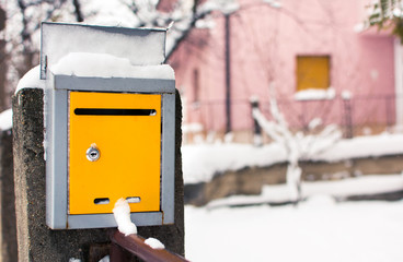 Snow covered mailbox in front of a house