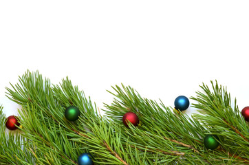 Branch of Christmas tree with balls on white background.
