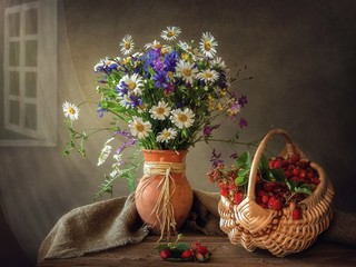 Still life with bouquet of summer wildflowers and strawberries