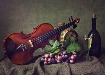Still life with viola and grapes