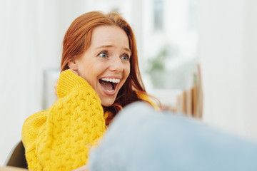 Amused young woman enjoying a good laugh