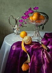 Still life with orchid flowers and orange fruits
