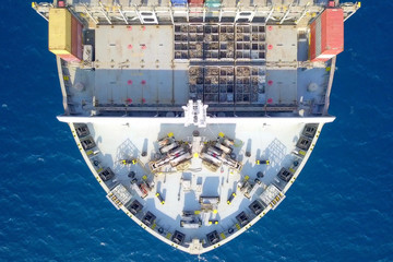 Container ship at sea - Aerial image of a ULCV (Ultra large container vessel) loaded with various container brands.