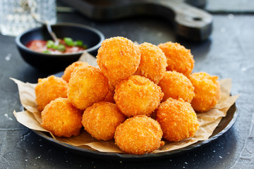 cheese balls with tomato sauce.